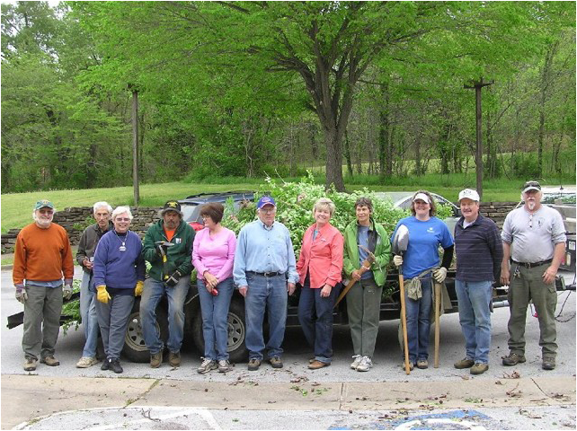 Three flatbed trucks were loaded with Euonymus by volunteers