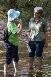 Chasing after native plants can be hard on your running gear!  ANPS President Betty Owen and member Susan Toone cool their feet in the refreshing waters of Bear Branch.